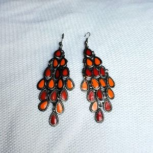 Orange and red dangle large earrings.
